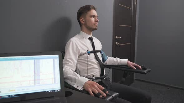 Thumbnail for Serious Man with Pulse Electrodes Connected To Polygraph