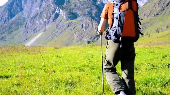 Thumbnail for Hiking Man Walking on Green Mountain Meadow with Backpack