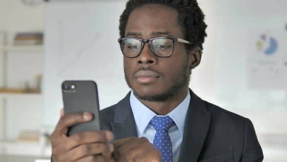 Thumbnail for African Businessman Using Smartphone