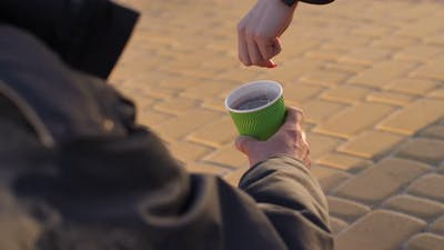 Homeless Beggar's Hand with Paper Cup