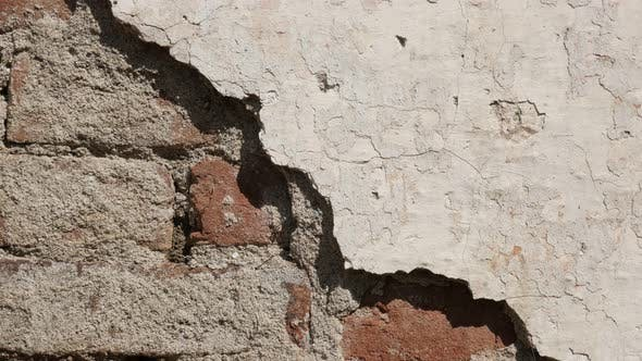 Slow tilt obsolete brick wall and white cement plaster  4K 2160p 30fps UltraHD footage - Old  destro