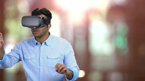 Indian Man Wearing Virtual Reality Goggles