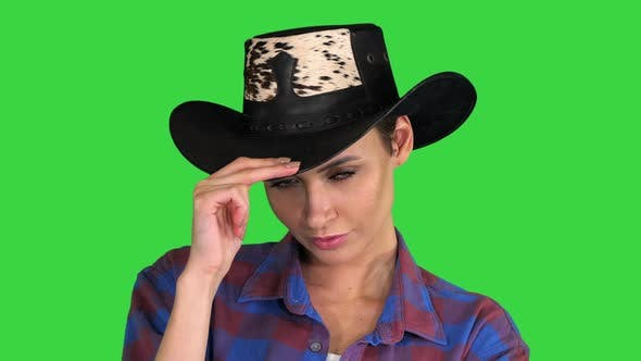 Thumbnail for Confident Woman in Cowgirl Hat Looking To Camera on a Green Screen, Chroma Key.