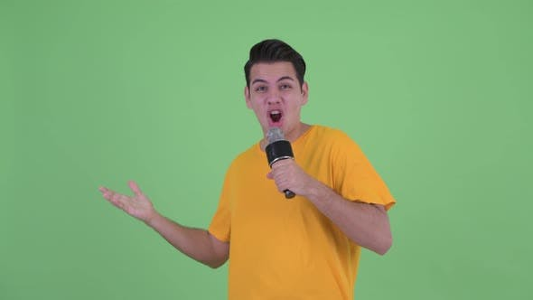 Thumbnail for Happy Young Multi Ethnic Man Singing with Microphone