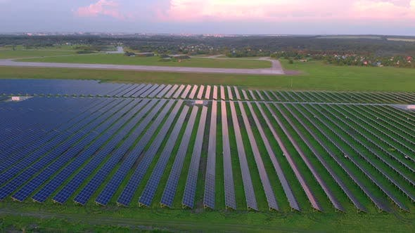 Drone Fly Over Solar Farm. Renewable Green Energy and Electrical Technology. Field of Solar Panels