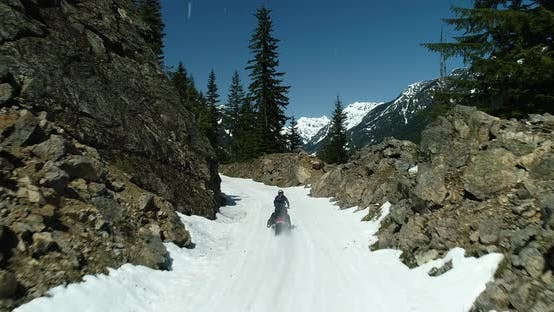 Snowmobile Motorsport Winter Snowy Trail Riding Through Rocky Cascade Mountain Pass