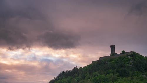 Time lapse at sunset: the fortress of Radicofani, a medieval village and fortress in Orcia Valley, T