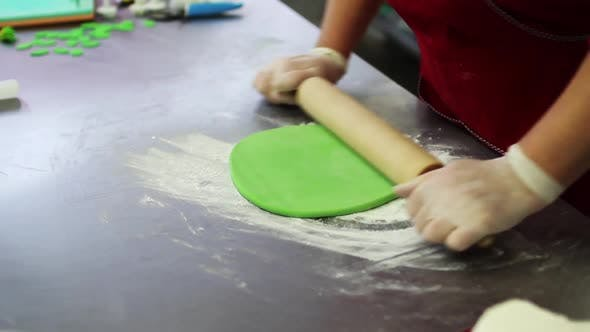Thumbnail for Woman Rolling Sugar Mastic with Rolling Pin on Table for Making Dessert