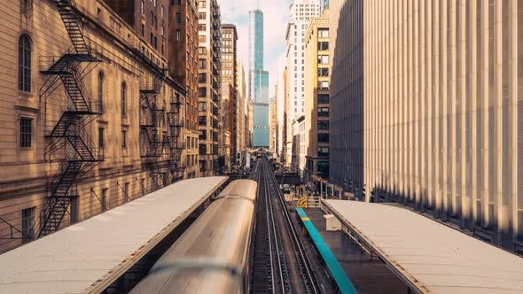Thumbnail for Time-lapse of trains arriving railway station between buildings in downtown Chicago, USA