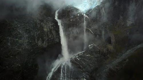 Aerial view of misty waterfall in Cisnes, Region de Aysen, Chile.