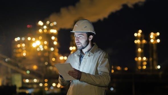 Thumbnail for Manager Working on Tablet standing near factory.