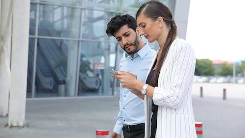 Work Trip. Business People Using Phone Walking At Airport