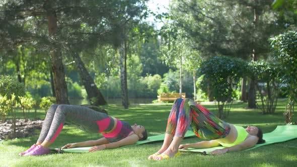 Thumbnail for Fitness Females Doing Half Bridge Pose Yoga Exercise