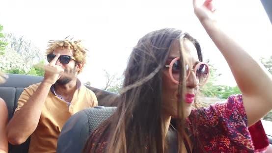 Thumbnail for Beautiful young woman having fun driving her friends in convertible