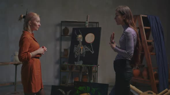 Art Critic Analyzing Paintings of Female Artist