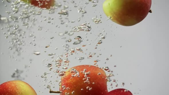 Thumbnail for Fresh Ripe Fruits Apples Red and Yellow Falling in Water Spinning and Rotating with Air Bubbles