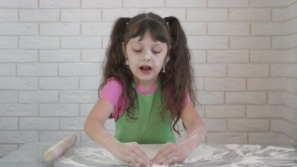 A child cooking homemade bread.