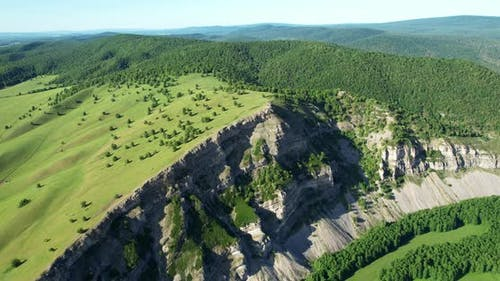 Rock and dense forest on the horizon