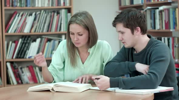 Thumbnail for Two Teens Studying at Library