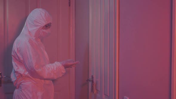 Thumbnail for Young Female Laboratory Worker Coming Into Room with Red Lighting, Closing Door By Key, and Leaving