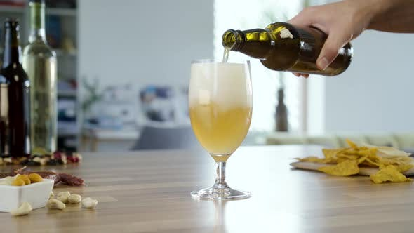 Pouring White Beer In To Glass