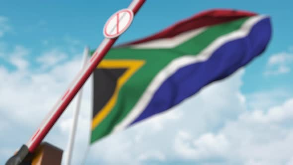 Thumbnail for Barrier Gate with STOP CORONAVIRUS Sign Closes with Flag of South Africa As Background