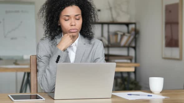 Thumbnail for Pensive African Businesswoman Thinking and Working on Laptop