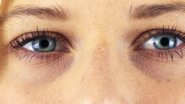 Thumbnail for A Woman Opens Her Blue Eyes - Closeup