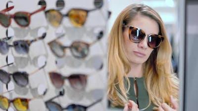 Woman Choosing Designer Sunglasses