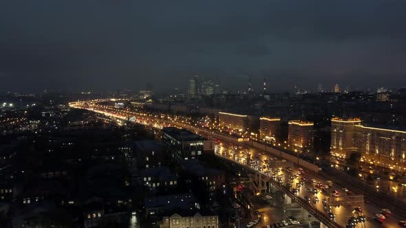 Thumbnail for An Aerial View of a Night City with a Busy Highway