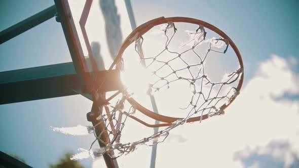 Thumbnail for A Basketball Training Outside. Throwing a Ball in a Basketball Hoop. The Ball Gets Right in Target