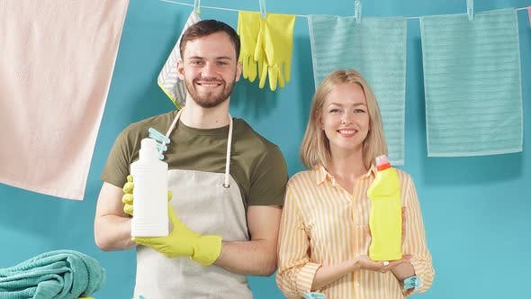 Thumbnail for Positive blonde woman and handsome bearded man advertising effective detergents