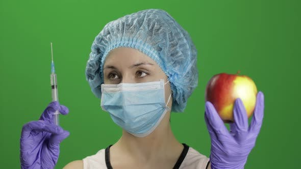 Thumbnail for Female Scientist Chooses Syringe with Medicines or an Apple