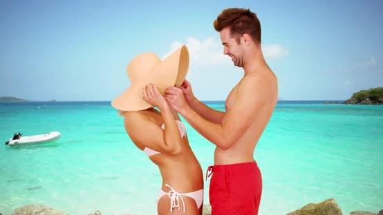 Thumbnail for White millennial couple enjoying their vacation at the beach