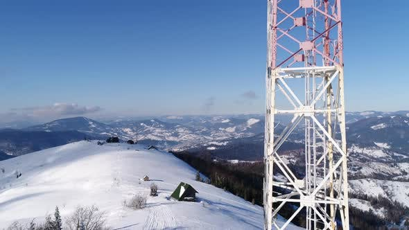 Thumbnail for Flying Over Radio Communications Tower, Mountain Snow Covered Winter Landscape