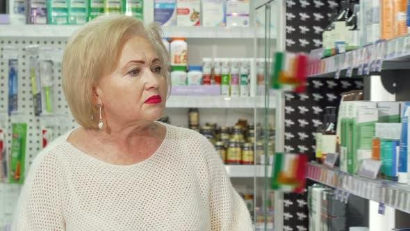Thumbnail for Charming Senior Woman Smiling To the Camera, Shopping at Drugstore