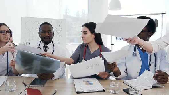 Thumbnail for Team of Doctors Having a Meeting in Conference Room in the Modern Hospital