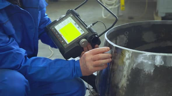 Thumbnail for Ultrasonic Check of Pipe Welds By Worker on Factory