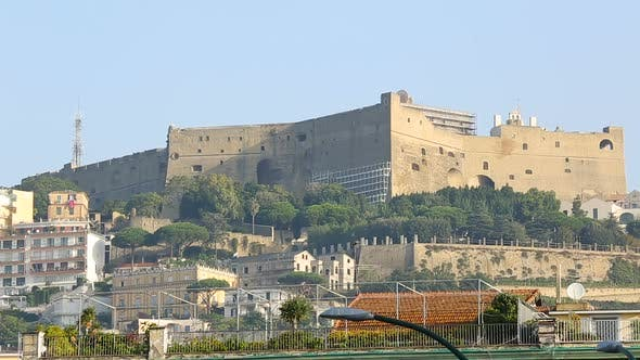 Gorgeous view on Castel Sant Elmo and embankment in Naples, tourism, sequence