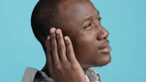 Profile of Black Man Touching His Painful Ear