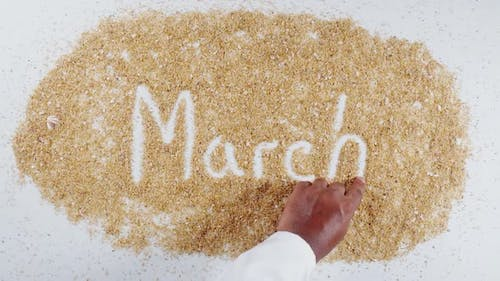 Hand Writes On Sand   March
