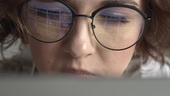 Cover Image for Attractive Young Hipster Girl Working at her Computer