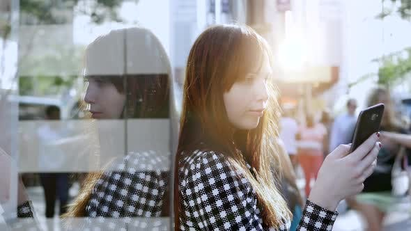 Thumbnail for Beautiful Female Person Using Smart Phone in the City
