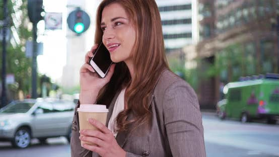 Thumbnail for Sexy businesswoman talking on the phone. Happy and laughing pretty woman in 20s using smartphone.