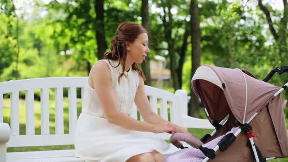 Thumbnail for Happy Mother with Baby in Stroller at Summer Park 9