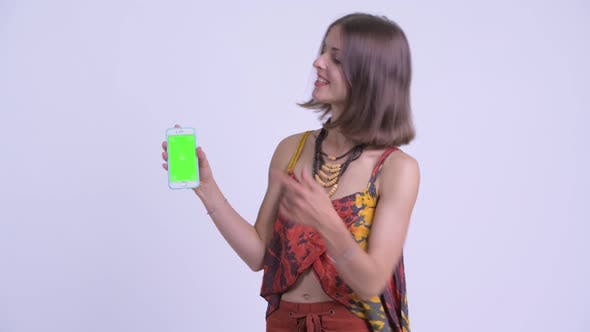 Thumbnail for Happy Young Beautiful Hipster Woman Talking and Showing Phone