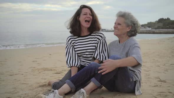 Cover Image for Senior Mother and Happy Daughter Touching Noses on Beach and Having Fun