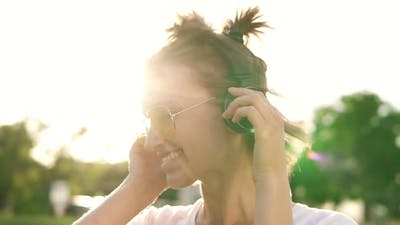 Close Up of Fair Hair Girl Dancing to the Rhythm of Music with Headphones