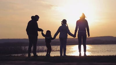 Silhouette of Family at the Coast