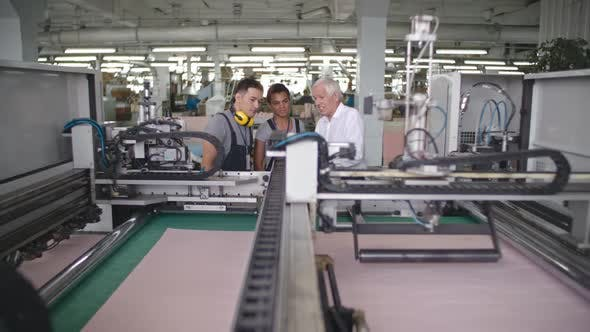 Cover Image for Elderly Manager Speaking about Automated Machinery